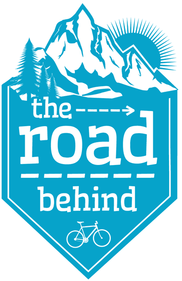 the road behind Travel Blog Logo
